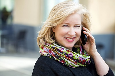 photo of mature attractive woman talking on her cell phone